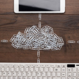 Cloud concept made of paperclips linked to devices