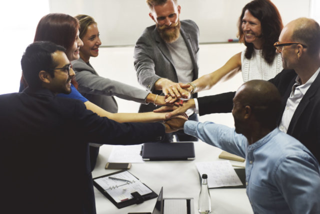 Business people showing teamwork with hands together
