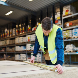 Warehouse worker measuring materials