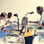 Electronics technicians team working on computer parts