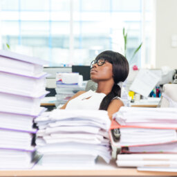Businesswoman sleeping at desk