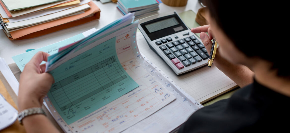 woman paying invoices, automation